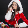 Santa girl answering the phone — Stock Photo