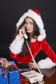 Santa girl answering the phone — Stock Photo