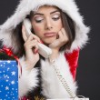 Unhappy Santa girl on the phone — Stock Photo