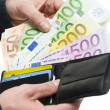 Male hands pulling out 100 hundred euro from the wallet — Stock Photo #16671901
