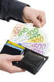Male hands pulling out 100 hundred euro from the wallet — Stock Photo
