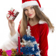 Christmas girl and presents — Stock Photo #16924041