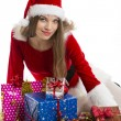 Christmas girl and presents — Stock Photo