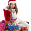Christmas girl with presents and snow — Stock Photo