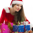 Christmas girl and presents — Stockfoto