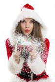Santa girl blowing snow — Stock Photo