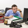 Confused accountant at work — Stock Photo