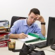 Stressed businessman at work — Stock Photo #18984521