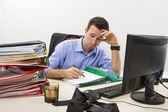 Stressed businessman at work — Stock Photo