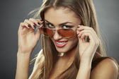 Chic, flirty and sunglasses — Stock Photo