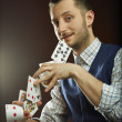 Magic with playing cards — Stock Photo