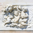 Stock Photo: Bas-relief marble sculpture with babies