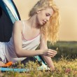 Beautiful blond woman camping — Stock Photo