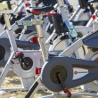 Stock Photo: Stationary spinning bikes rows