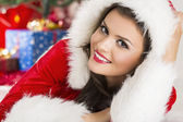 Smiling lady in Santa outfit — Stock Photo