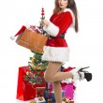 Sensual Santa girl with presents — Stock Photo