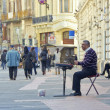Busker playing the cimbalom — Stock Photo