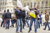 Men fighting with pillows — Stock Photo