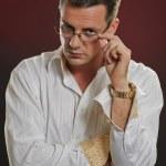 Suspicius man looking over eyeglasses — Stock Photo #48349087