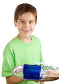 Happy boy with money and house on the tray — Stock Photo