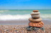 Stack of balanced stones on the beach — Stock Photo