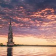 Submerged bell tower in river on a beautiful sunrise — Stock Photo