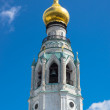 Majestic bell tower with golden dome in shape of bulb — Stock Photo #12025060