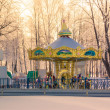 Carousel closed in winter park under snow park with white trees — Stock Photo