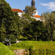 Park with pond in old european city - Stock Photo