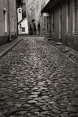 Monochrome photo of old european street — Stock Photo