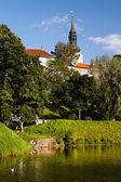 Park with pond in old european city — Stock Photo