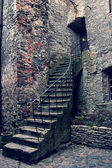 Retro image of old stone stairs and house — Stock Photo