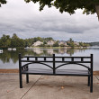 Park with bench, trees and lake — ストック写真