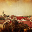 Retro stye panoramic view of Tallinn old city center - Stock Photo