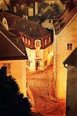Vintage style photo of old European town at night — Stock Photo
