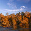 Stock Photo: Beautiful fall colors forest reflected in river