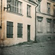 Vintage style photo of old European town street — Foto de Stock