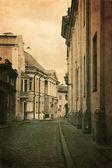 Vintage style photo of old European town street — Stock Photo