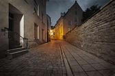 Retro style photo of old European street at night — Stock Photo