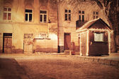 Retro image of old European town at night — Stock Photo