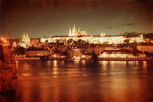 Vintage style photo of Prague at night — Stock Photo
