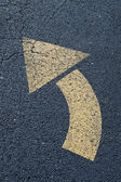 Arrow left turn sign on the road — Stock Photo