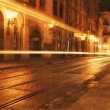 Traffic in old european city at night - Stock Photo