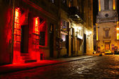Illuminated street at night — Foto Stock
