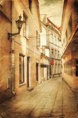 Retro style image of old european street — Stock Photo
