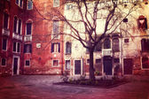 Retro style photo of small square in Venice — Stock Photo