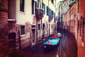 Retro style image of small canal in Venice — Stock Photo
