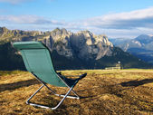Lounge chair with mountain view — Stock Photo