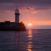 Lighthouse on sunrise — Stock Photo