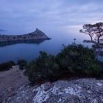 Sunset on rocky coast of Black sea — Stock Photo #46897787